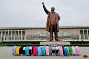 Bowing Before the Feet of The Great Leader in North Korea